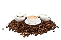 Caffè, crema e zucchero di canna fotografia stock libera da diritti