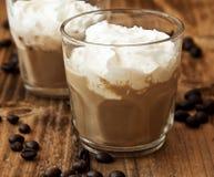 Caffè del Latte in vetri con crema Fotografie Stock