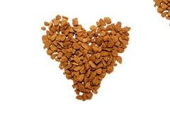 Caffè di amore, granelli del caffè istantaneo di forma del cuore - arrosto medio immagine stock libera da diritti
