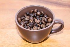Caffè di Brown in tazza Fotografia Stock