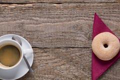Caffè di mattina con la ciambella Fotografia Stock