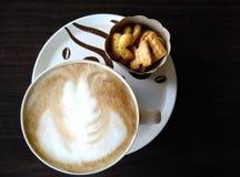 Caffè e biscotto caldi Fotografia Stock