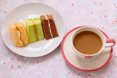 Caffè e dolce arancio Fotografia Stock