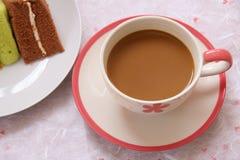 Caffè e dolce arancio Immagine Stock Libera da Diritti