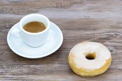 Caffè espresso e ciambella Fotografie Stock