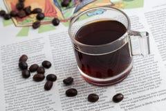 Caffè espresso uno sparato sulla carta di NOTIZIE Fotografia Stock Libera da Diritti