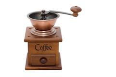 Caffè-laminatoio di legno su priorità bassa bianca Fotografia Stock Libera da Diritti