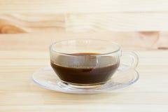 Caffè nero sulla tabella di legno Immagine Stock