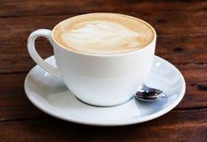 Caffè su una tavola Fotografie Stock Libere da Diritti