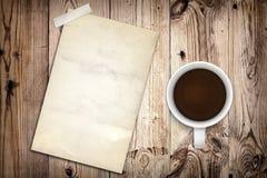 Caffè e vecchio manifesto Fotografie Stock