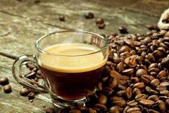 Caffè espresso e chicco di caffè Immagini Stock