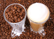 Caffe latte and coffee beans Royalty Free Stock Photo