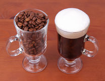 Caffe latte and coffee beans Stock Photography