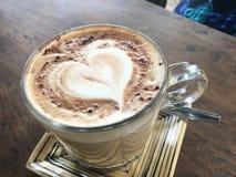 Caffe Mocha,Heart-shaped bubble. Heart-shaped bubble Caffe Mocha in a yellow saucer Stock Image