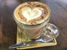 Caffe Mocha Heart-shaped yellow saucer. Heart-shaped bubble Caffe Mocha in a yellow saucer royalty free stock image