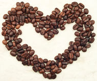 Caffee beans heart. On paper background Royalty Free Stock Image