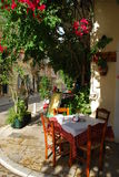 Caffee restaurant. A beautiful small table on the corner of a street in a restaurant in Kerkyra Stock Photos