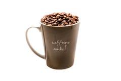 Caffeine addict. A big mug of coffee with coffee beans Stock Image