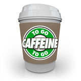 Caffeine Coffee Plastic Cup Drink Drive-Thru To-Go. The words Caffeine To Go on a plastic coffee cup from a cafe or restaurant Royalty Free Stock Images