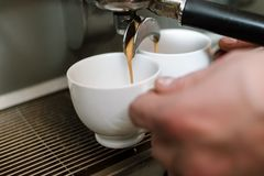 Caffeine dependency morning energy coffee pour. Caffeine dependency concept. morning energy drink. barista making two cups of hot fresh strong coffee. beverage royalty free stock photo