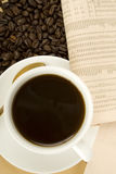 Caffeine Drink & Newspaper Royalty Free Stock Photography