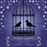 Cage à oiseaux sur le fond floral bleu Photo libre de droits