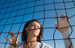 In a cage. Girl&volleyball net Stock Photography