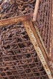 Cage avec du fer de chute Images stock