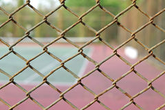 Cage of blurred tennis court background. Cage of blurred tennis court blur background royalty free stock photo