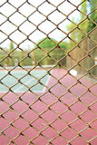 Cage of blurred tennis court background. Cage of blurred tennis court blur background royalty free stock images