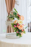 Cage decoration as flowers. White cage decoration as flowers on wedding day Stock Images