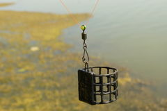 Cage feeder. A quiver tip is a flexible extension to a fishing rod which is designed to move, or quiver, when a fish takes the bait. The main characteristic of royalty free stock images