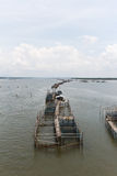 Cage fish farming in the river Stock Photos