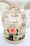 Cage with flowers arrangement Royalty Free Stock Image