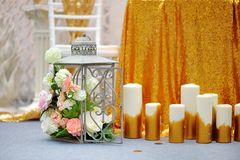 Cage with flowers and candles as decoration Royalty Free Stock Image
