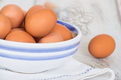 Cage free, brown hen eggs in a bowl Stock Images