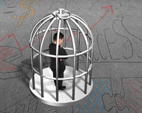 Cage with man thinking inside. On business doodles concrete floor background Stock Photo