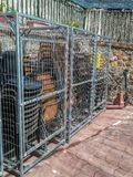 Cage to store outdoor chairs in the square of Pavias royalty free stock images