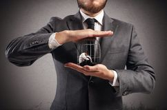Caged  businessman. Boss holds in hands a caged man Royalty Free Stock Image