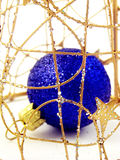 Caged christmas ball Stock Images