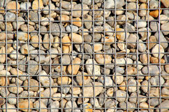 Caged pebbles Royalty Free Stock Photo