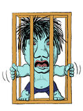 Caged Troll. An angry troll in a cage Stock Image