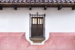 Caged window with cross decoration in Antigua, Guatemala. Caged window in colonial style with cross decoration in Antigua, Guatemala stock image