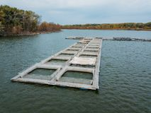 Cages For Sturgeon Fish Farming In Natural River Or Pond, Aerial View Stock Photos