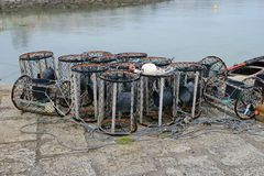 Cages for shellfish drying on shore. Image of cages for shellfish drying on shore Royalty Free Stock Image
