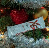 CAGLIARI, ITALY - DECEMBER 2018: XS Sport Nutrition protein bar on a christmas tree. Nutrilite natural and vegan supplements. Natu stock photography