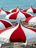 Cagnes-sur-Mer (Cote d'Azur). Cagnes-sur-Mer (Alpes-Maritimes, Provence-Alpes-Cote d'Azur, France), red and white umbrellas on the beach Stock Images