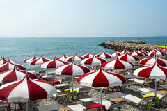 Cagnes-sur-Mer (Cote d'Azur). Cagnes-sur-Mer (Alpes-Maritimes, Provence-Alpes-Cote d'Azur, France), red and white umbrellas on the beach Royalty Free Stock Photography