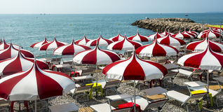 Cagnes-sur-Mer (Cote d'Azur). Cagnes-sur-Mer (Alpes-Maritimes, Provence-Alpes-Cote d'Azur, France), red and white umbrellas on the beach Royalty Free Stock Image