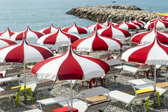 Cagnes-sur-Mer (Cote d'Azur). Cagnes-sur-Mer (Alpes-Maritimes, Provence-Alpes-Cote d'Azur, France), red and white umbrellas on the beach Stock Photography